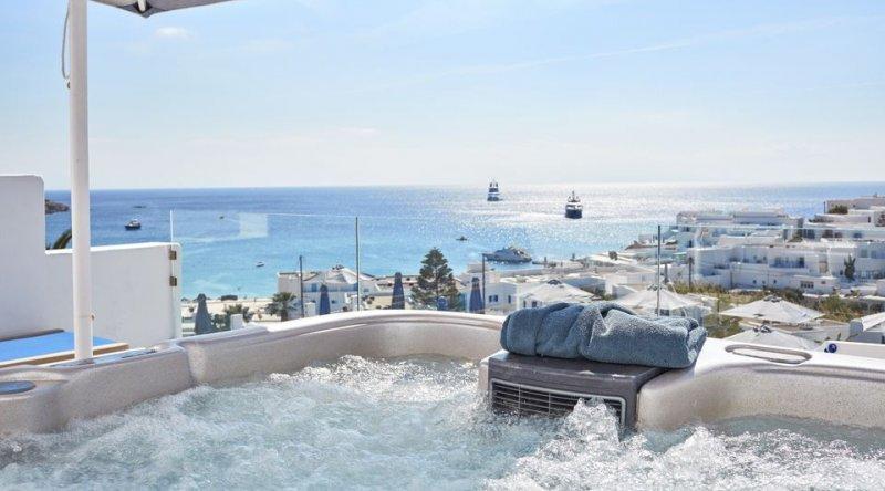 Azure Suite with Private Jacuzzi Sea View Myconian Ambassador Relais & Chateaux Hotel
